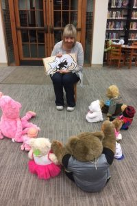 Miss Audie reads -- With Big Baloo and his furry friends gathered around, Miss Audie read fun and funny, sweet and scary stories. Come visit and pick out books you'd like to read to your best furry friend!